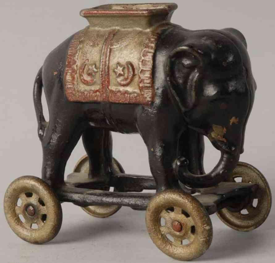 williams ac cast iron toy elephant on wheels still bank black red yellow