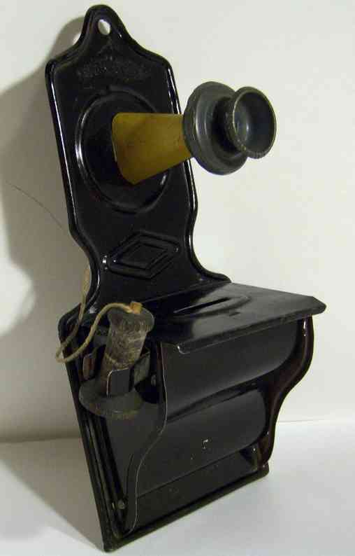wyandotte tin toy mechanical bank telephone bank with coin plub in back, made of tin