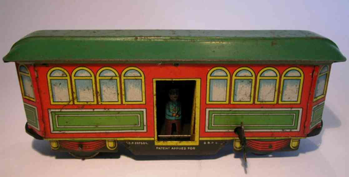 fischer heinrich tin toy tram streetcar with clockwork. streetcar drives, conks out, the b