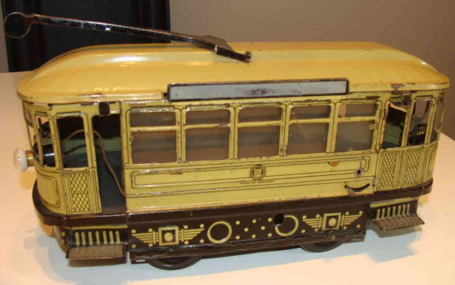 guenthermann 74 tin toy tram trolley in beige and brown