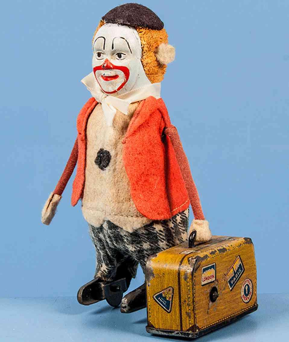schuco 786 blech tanzfigur clown mit koffer