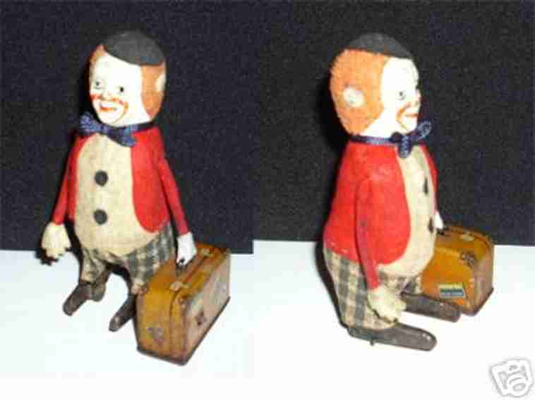 schuco 786 tin dance figure clown with suitcase