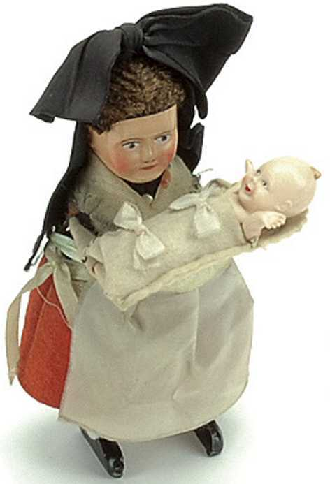 schuco 931 tin dance figure breisgauerin dress compress pillow baby