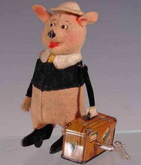 schuco 780 980/6 tanzfigur schweinchen mit reisekoffer