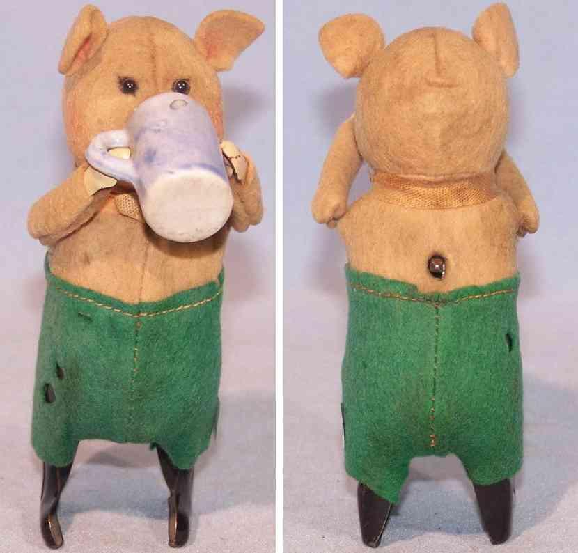 schuco 980/6 tin dance figure piglet with jug