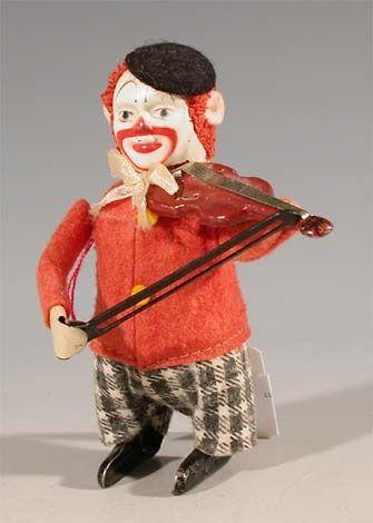 schuco 986/1 tin dance figure clown with violin