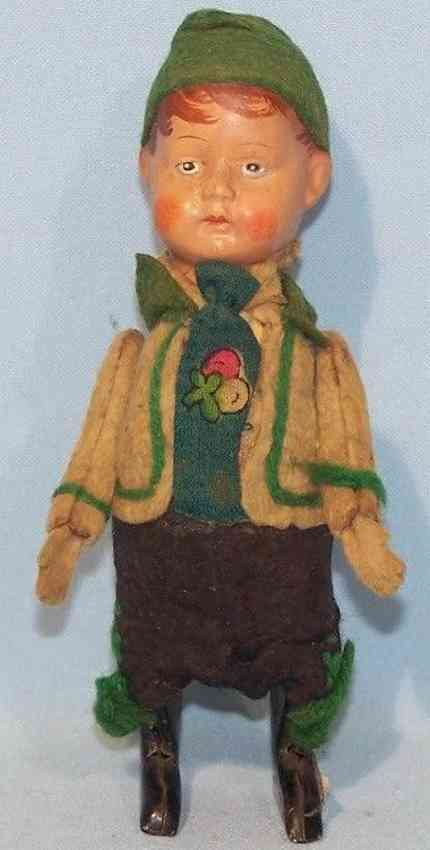 schuco tin dance figure boy in costume with porcelain head and clockwork