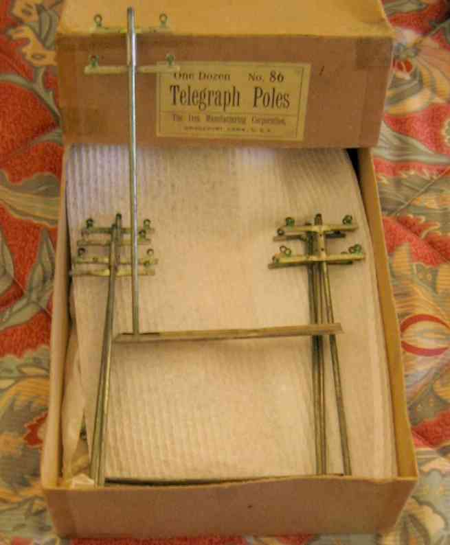 ives 86 (1909) railway toy telegraph set of telegraph poles with a 1 gauge set  and appear to hav