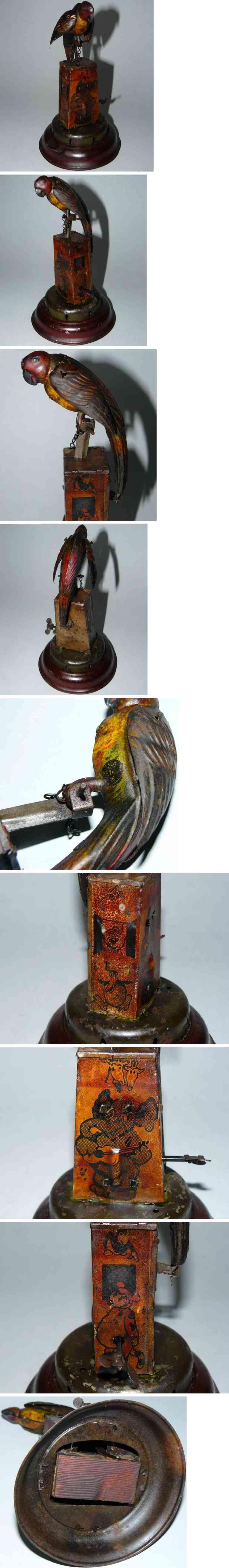 distler blech spielzeug piepsender papagei uhrwerk baumstumpf