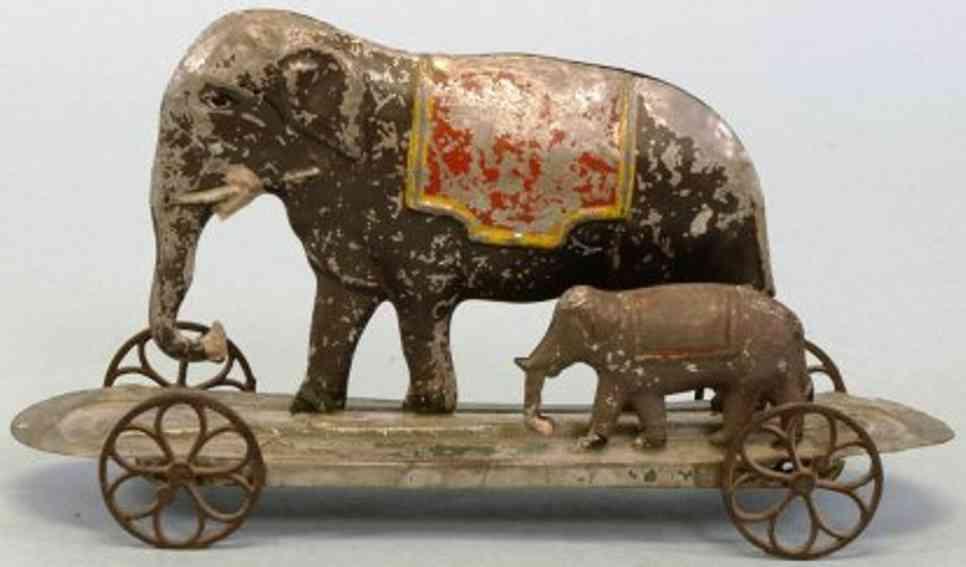 fallows tin toy two elephants on platform
