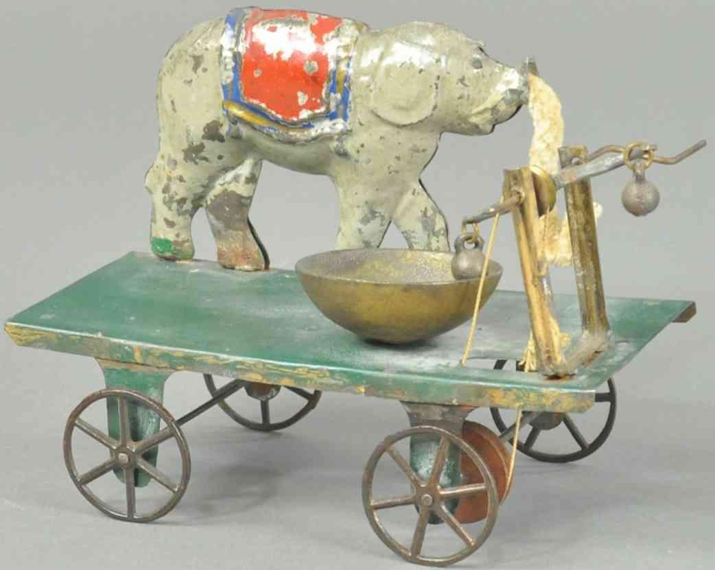 fallows blech elefant auf plattform glockenspielzeug