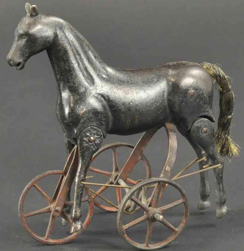 ives spielzeug gusseisen laufendes pferd drei raeder schwarz rot