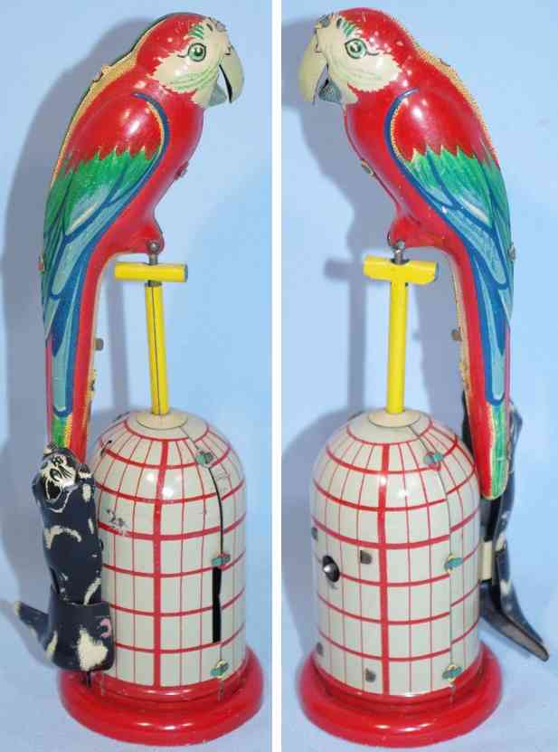 lineol 659 tin toy parrot with cat and clockwork