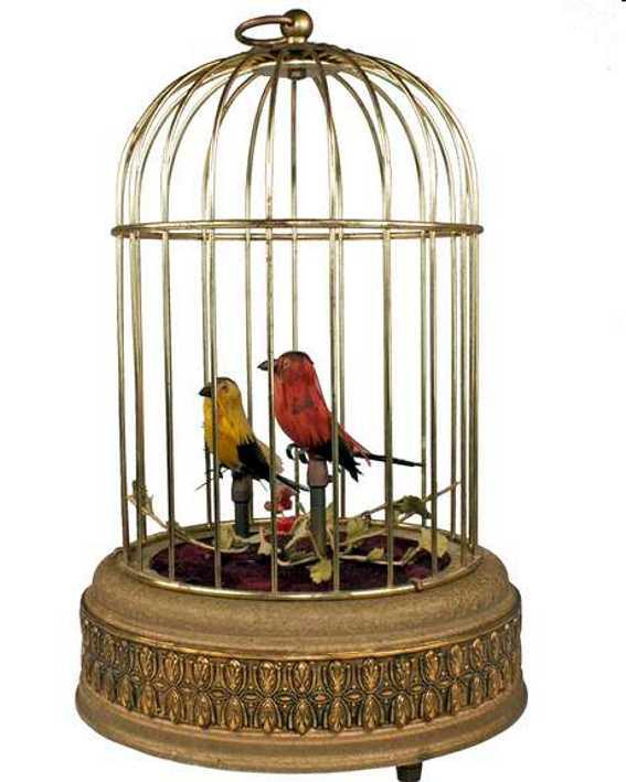 2 mechanische Singvögel im Messingkäfig