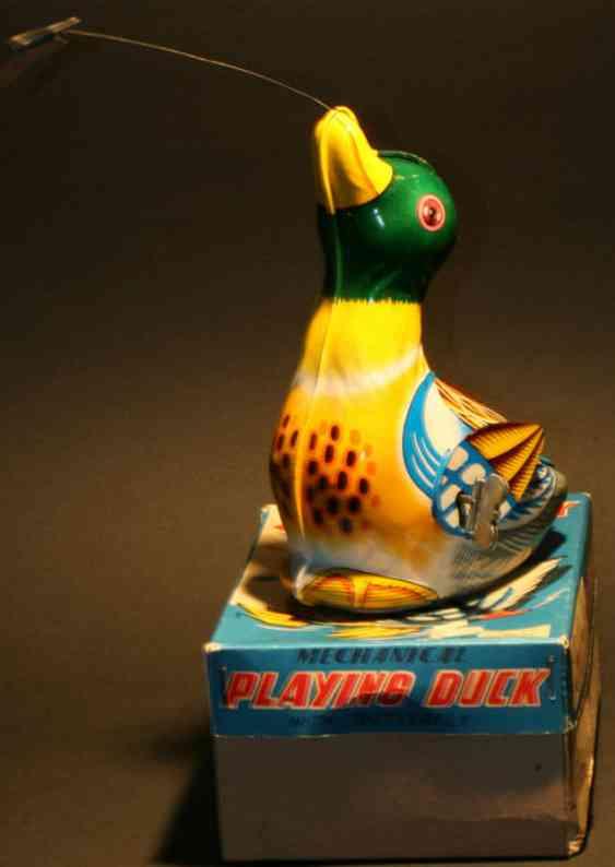 yonezowa gangu tin toy duck with fixed key, wound up it runs forward, goes strike a